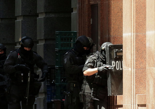 Armed policeman are seen outside Lindt Cafe