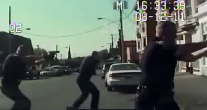 Screenshot from dashcam video showing police involved in the shooting death of Luis Rivera in Schenectady, NY, 2011.