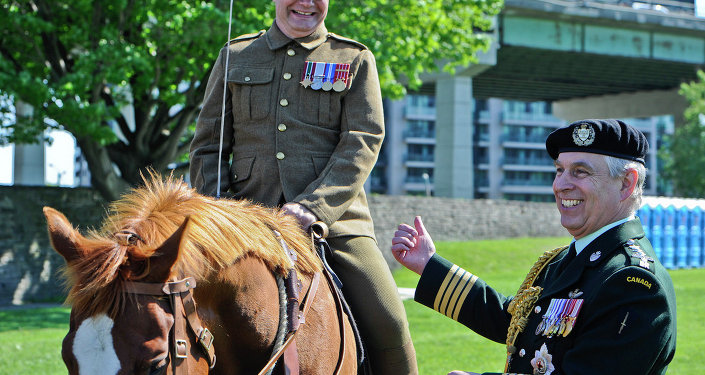 His Royal Highness Prince Andrew, The Duke of York shares a joke with Lt.-Col. Kevin Winiarski, a member of the 'Old Guard' of the Queen's York Rangers, during a parade at the Fort York National Historic Site in Toronto on June 05, 2014