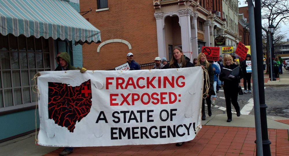 Ohio residents took to the streets to protest hydraulic fracturing, or fracking, the oil and gas drilling process expanding across the state, after a series of earthquakes were felt areas near fracking wells in March, 2014.