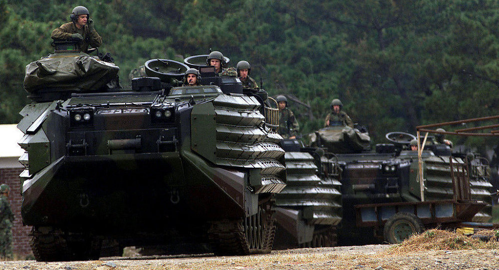 Several U.S. Marine Amphibious Assault Vehicles prepare for the combined amphibious beach assault at Tak San Ri Beach near Pohang during a field training drill conducted annually in South Korea