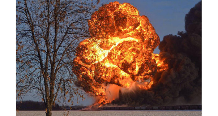 A fireball explodes into the air after two trains derailed outside Casselton, North Dakota, in December. One was carrying Bakken crude oil.