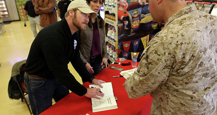 The real Chris Kyle signs copies of his book at Camp Pendleton in 2012