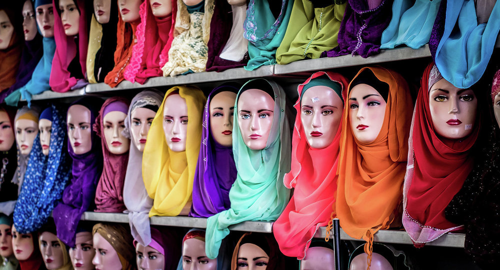 Muslim headscarfs and hijabs in a range of colors are for sale at an Indonesian market