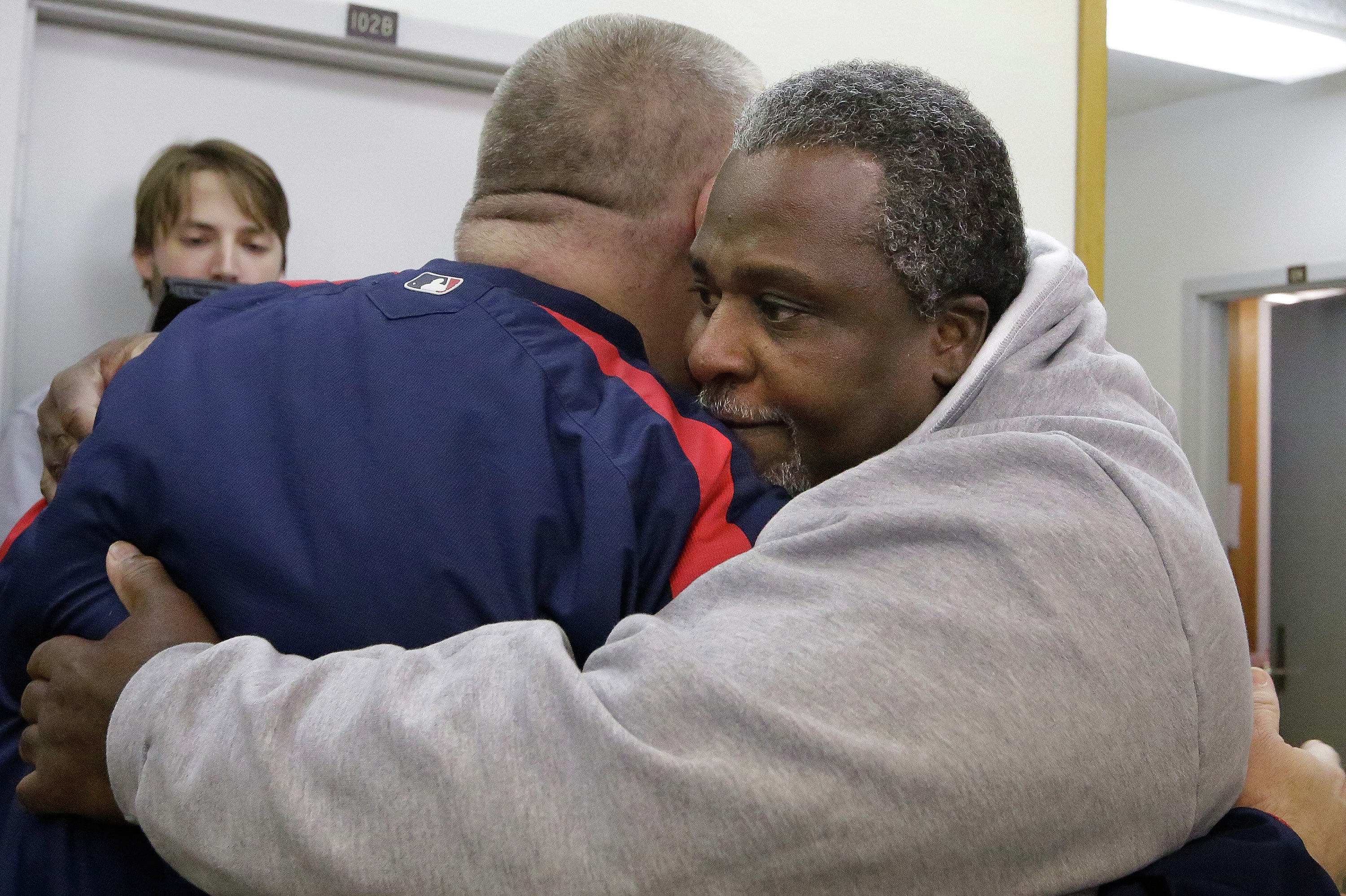 Alstory Simon, right, hugs supporter Shawn Rech, left, while leaving the Jacksonville Correction Center as a free man.