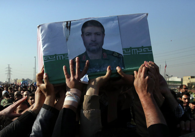 Civilians and armed forces members carry the coffin of Iranian Revolutionary Guard Brig. Gen. Mohammad Ali Allahdadi