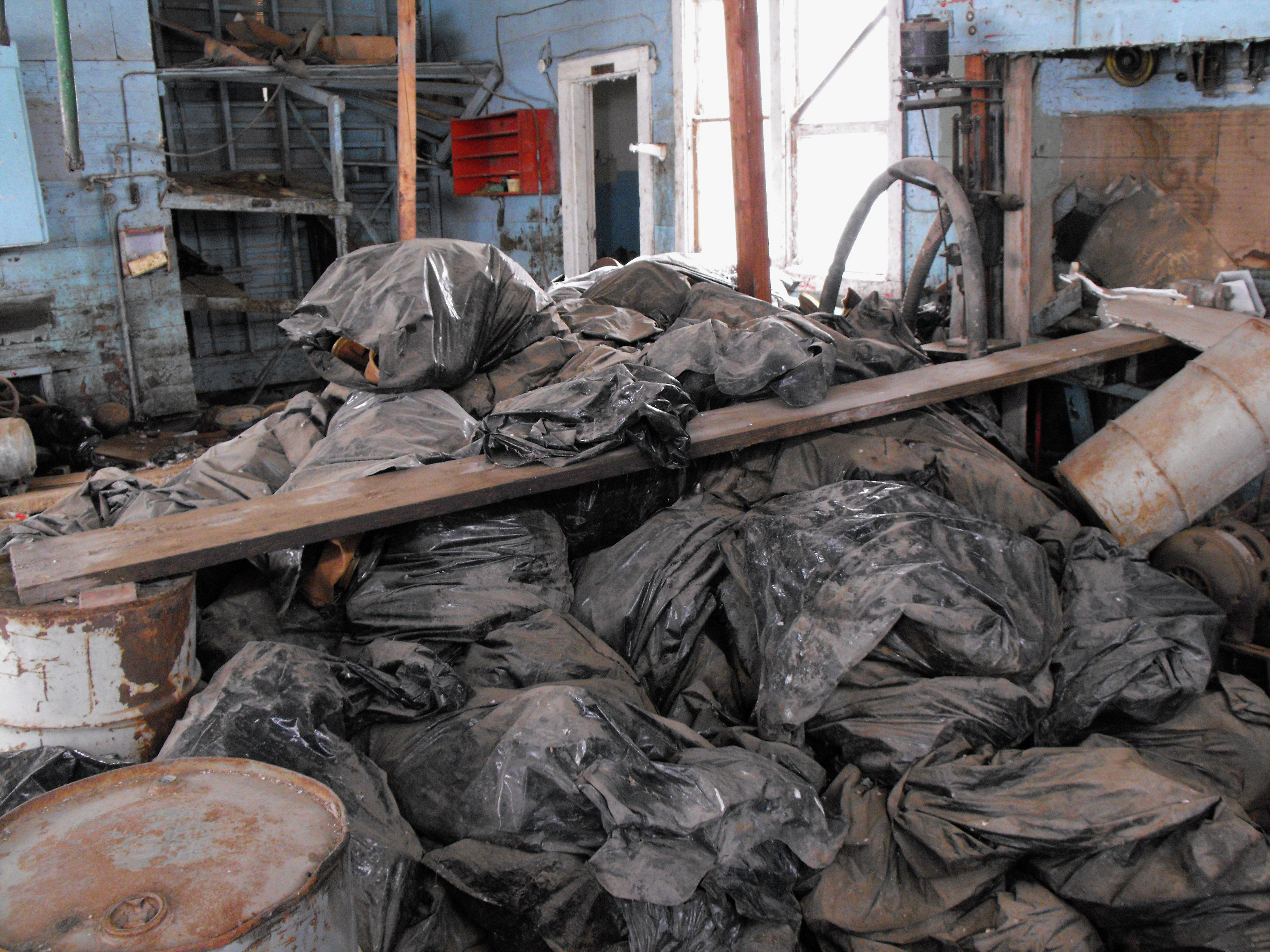 Bags full of radioactive oil filter socks, the nets that strain liquids during the oil production process, piled in an abandoned building in Noonan, N.D. North Dakota