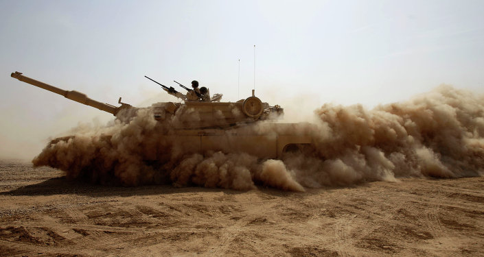 An Iraqi Army M1A1 Abrams tank, purchased from the U.S., maneuvers during a live fire exercise outside Baghdad, Iraq, Tuesday, Oct. 18, 2011. With the U.S. military scheduled to leave Iraq by the end of the year, the Iraqi security forces will be soley responsible for providing security for the country.
