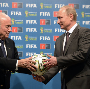 Russia's President Vladimir Putin (R) and FIFA President Joseph Blatter during the 2014/2018 FIFA World Cup handover ceremony. July 13, 2014.