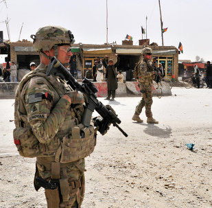 US Army soldiers provide security for members of their team near the Afghanistan-Pakistan border