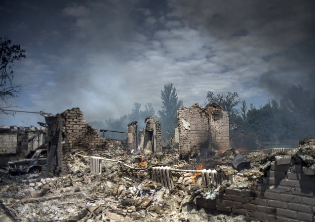A house destroyed in the Ukrainian armed forces' air attack on the village of Luganskaya