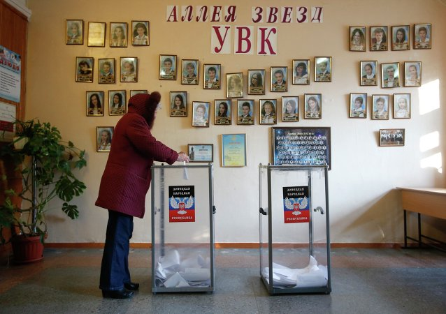 A woman casts a ballot during the self-proclaimed Donetsk People's Republic leadership and local parliamentary elections at a polling station in Donetsk, eastern Ukraine