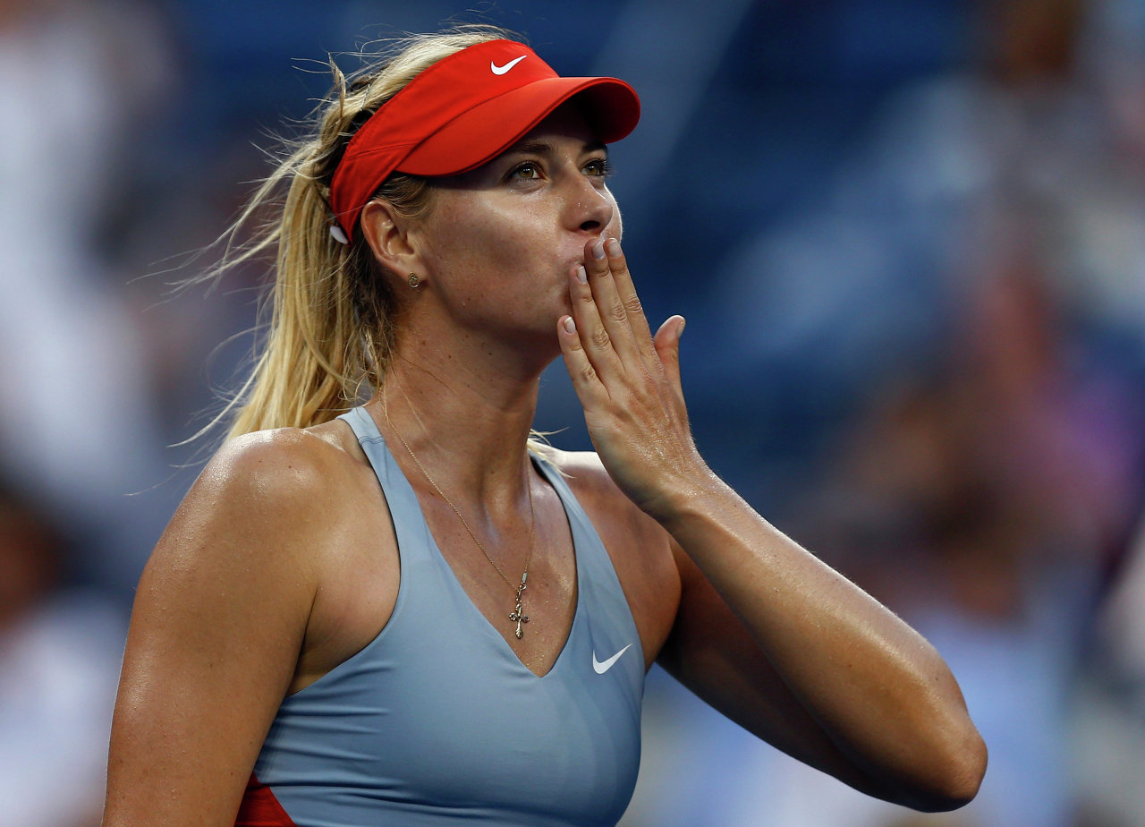 Maria Sharapova, of Russia, blows kisses to the crowd after defeating Alexandra Dulgheru, of Romania, during the second round of the 2014 U.S. Open tennis tournament, Wednesday, Aug. 27, 2014, in New York