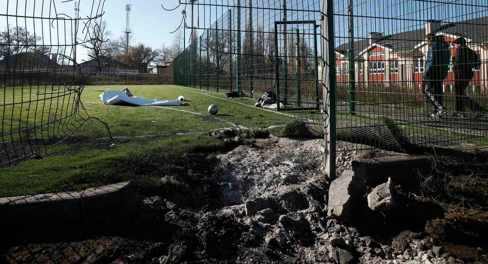 A crater caused by shelling is seen near a school's soccer field in Donetsk, eastern Ukraine, November 6, 2014