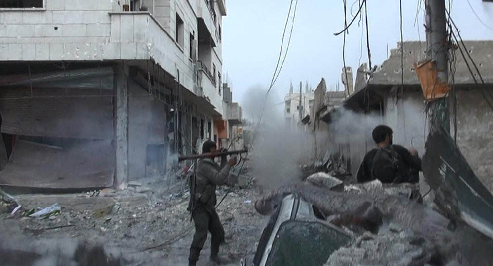 This undated file photo posted on Monday, Nov. 4, 2014 by the Raqqa Media Office of the Islamic State group, a militant extremist group, shows fighting in Kobani, Syria