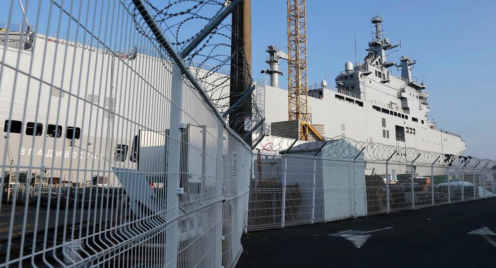 The Vladivostok warship docks on the port of Saint-Nazaire, western France, Friday, Sept.5, 2014
