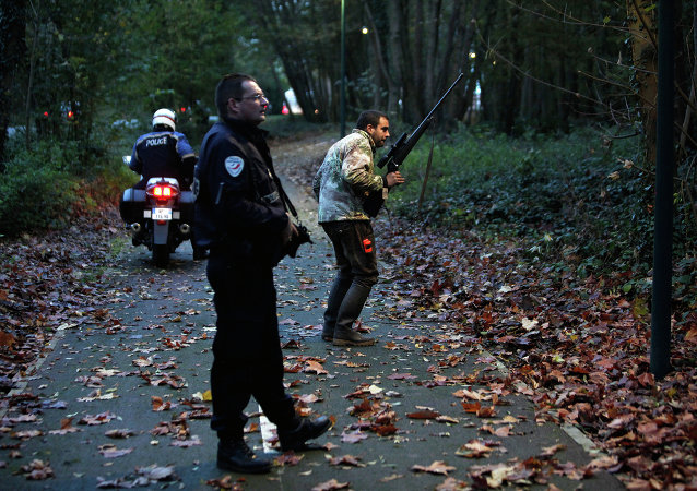 Members of the police animal brigade walk through a wood in Montevrain, east of Paris, Thursday Nov. 13, 2014