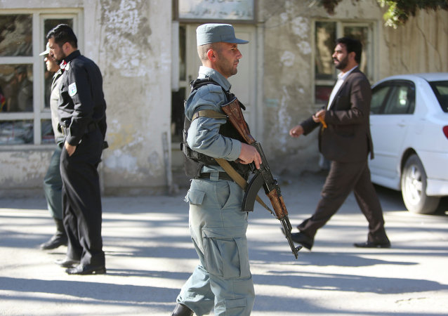 Afghan Police patrols near the site of a suicide attack in Kabul, Afghanistan