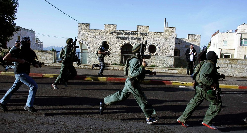 Israeli security personnel run next to a synagogue, where a suspected Palestinian attack took place.