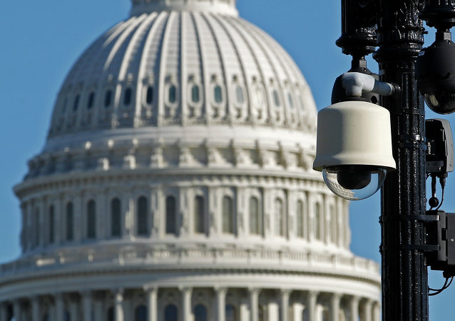 Surveillance cameras are visible near the U.S.Capitol in Washington Saturday, Oct. 26, 2013