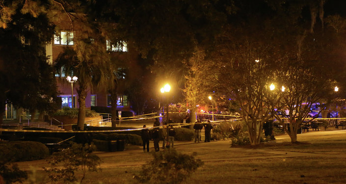 Police investigate a shooting scene at Strozier Library on Florida State campus on Thursday, Nov. 20, 2014, in Tallahassee, Fla