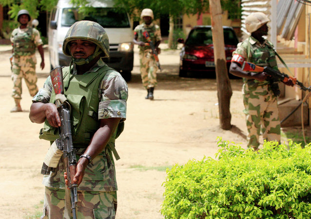 Nigerian soldiers stand guard at the offices of the state-run Nigerian Television Authority in Maiduguri, Nigeria. Archive photo.