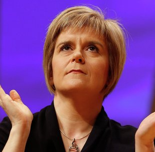 Nicola Sturgeon reacts as she is formally announced as the new Scottish National Party (SNP) leader at the party conference in Perth November 14, 2014