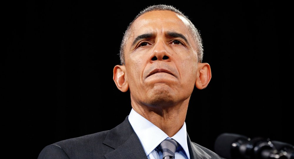 U.S. President Barack Obama pauses while speaking about immigration reform during a visit to Del Sol High School in Las Vegas, Nevada November 21, 2014