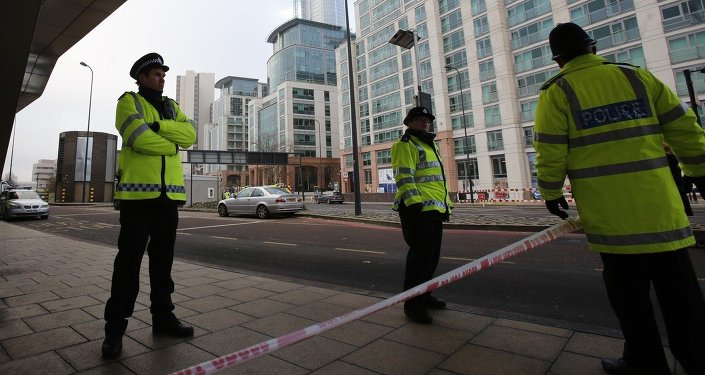 Police cordon a scene where a helicopter crashed in London, Britain