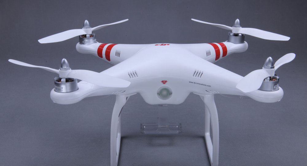 In this January 13, 2013 photo provided by DJI North America is the Phantom drone. The $700 Phantom, made by Chinese company DJI, is at the forefront of bringing drone technology to the masses.