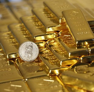 Gold bars and a Swiss Franc coin are seen in this illustration picture taken at the Austrian Gold and Silver Separating Plant 'Oegussa' in Vienna November 7, 2014