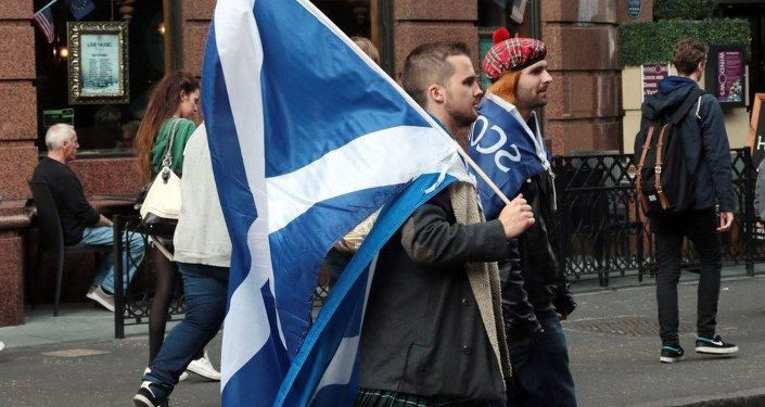 Yes campaigners carry flags on the day Scottish residents decide the future political direction their country will take in Glasgow,Scotland on September 18, 2014