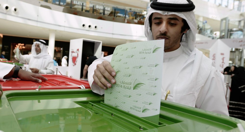 A voter casts his vote during parliamentary elections, at a polling station set up at the Seef Mall shopping centre in Manama November 22, 2014