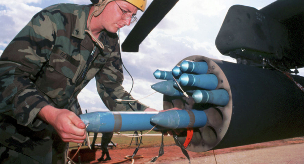 In this undated handout photo released by General Dynamics, a technician loads Hydra-70 rockets