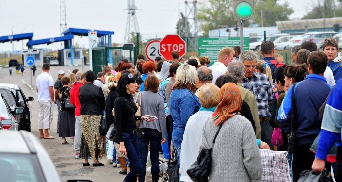 Ukrainian refugees at a border crossing point in the Rostov Region