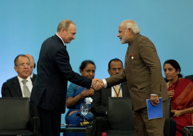 Russia's President Vladimir Putin, left, shakes hands with India's Prime Minister Narendra Modi