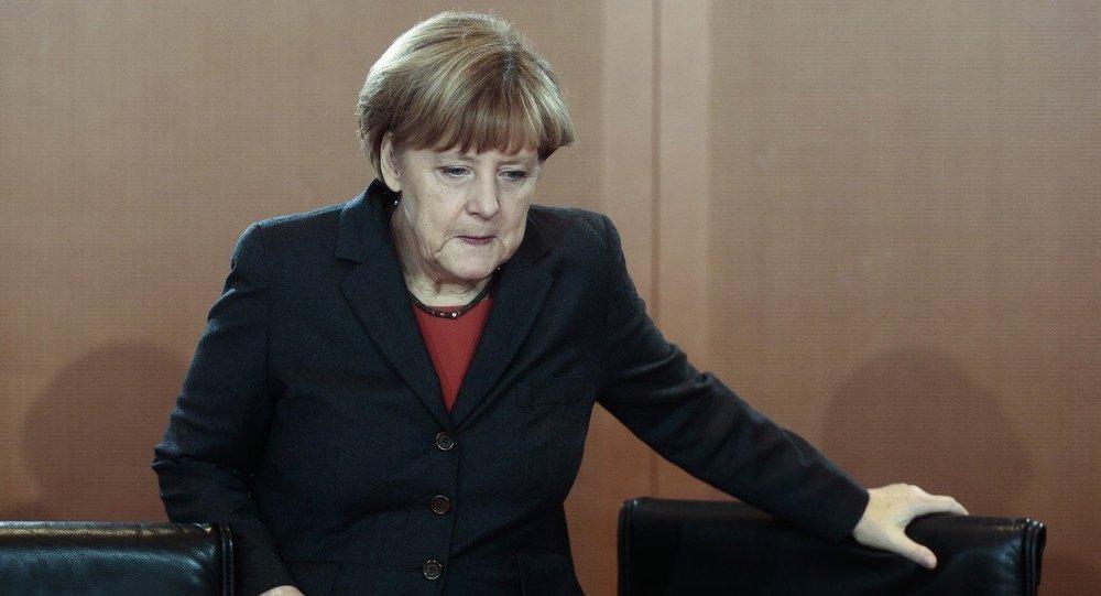 German Chancellor Angela Merkel arrives for the cabinet meeting in Berlin, Germany, Wednesday, Dec. 3, 2014