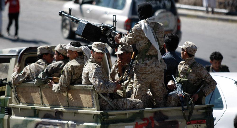 Yemeni soldiers patrol a street near the Defense Ministry compound in Sanaa, Yemen, Saturday, Dec. 7, 2013