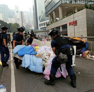 Police remove a sofa