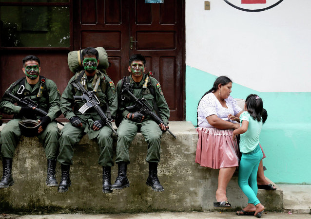 Members of the Bolivian combined forces of army and police rest at their headquarters at the end of their ceremony for the task of fighting against drugs and the eradication of coca leaves in Chimore, east of La Paz