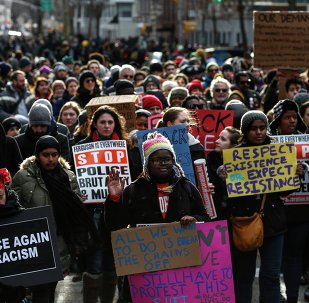 People take part in a march against police violence, in New York December 13, 2014