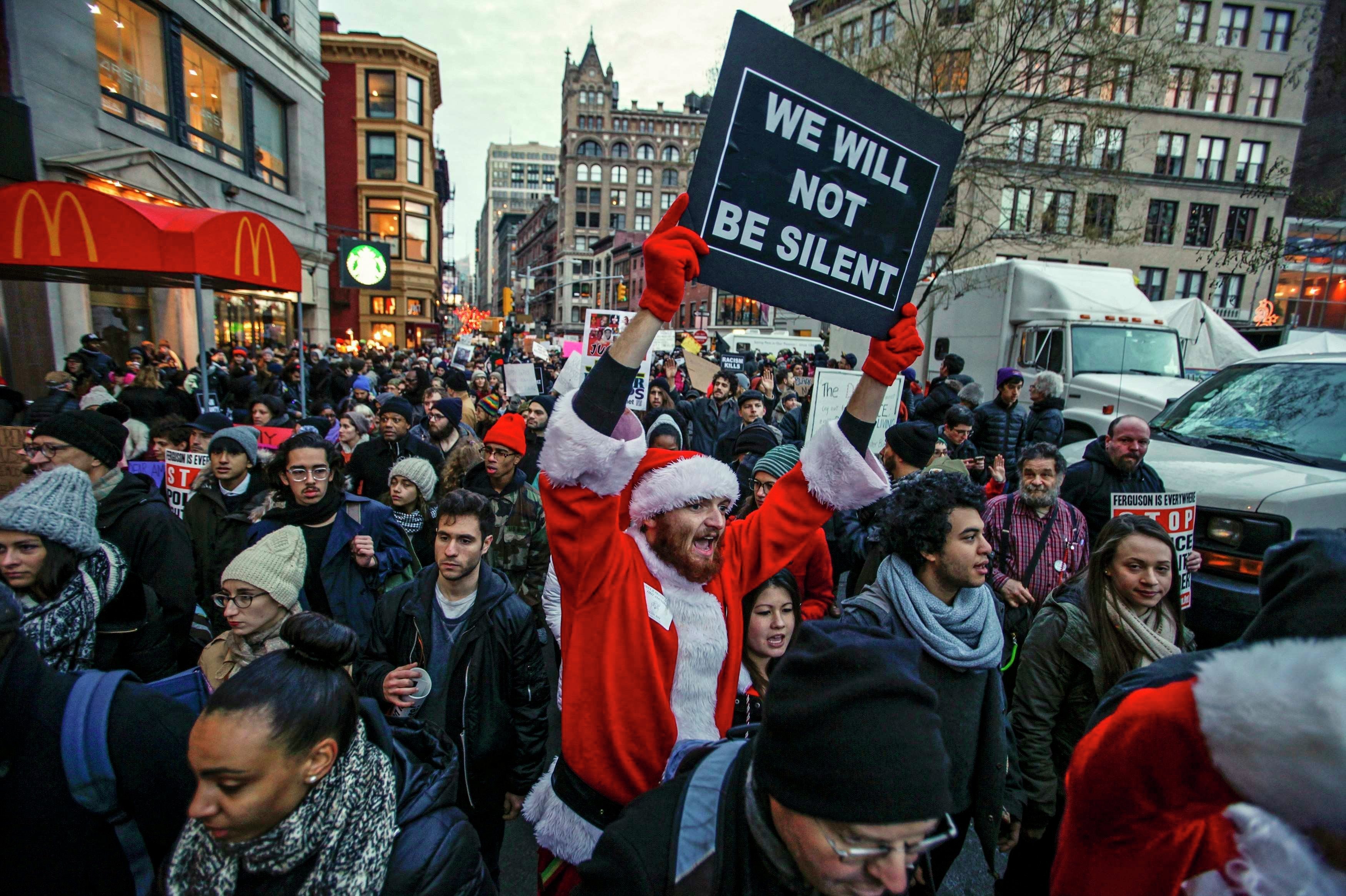 A man dressed as Santa Claus joins protesters in a march against police violence, in Midtown Manhattan, New York December 13, 2014