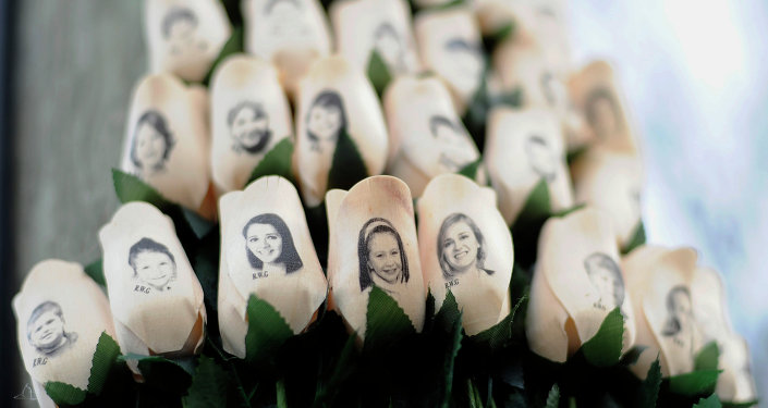 White roses with the faces of victims of the Sandy Hook Elementary School shooting