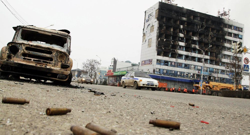 A burnt-out car is seen near the Press House building, a local media agency, in the Chechen capital Grozny, December 4, 20
