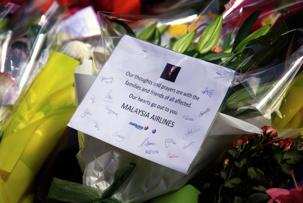 Flowers from the staff of the Malaysia Airlines company in memory of the dead in cafe in Sydney, Australia