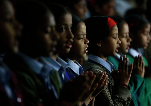 India schoolgirls offer prayers for victims killed in a Taliban attack