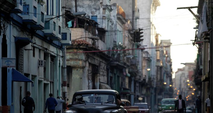 A car used as a taxi drives through the streets of Havana December 19, 2014.