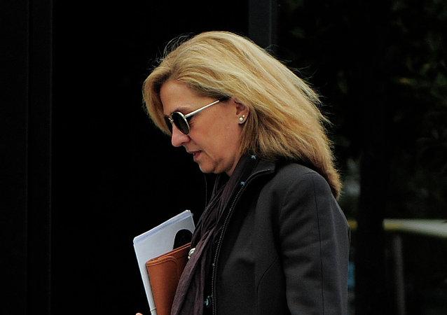 In this April 5, 2013 file photo, Spain's Princess Cristina walks toward her office in Barcelona, Spain