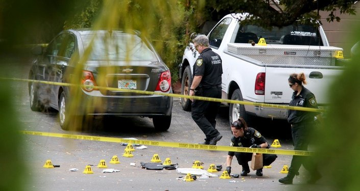 Forensic investigators with the Pinellas County Sheriff's Office investigate the scene where 45-year-old Tarpon Springs police officer Charles Kondek was shot and killed, Sunday, Dec. 21, 2014, in Tarpon Springs, Fla