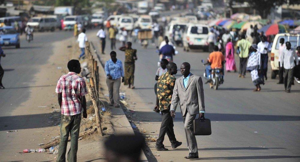 People walk on a street in Juba, southern Sudan,